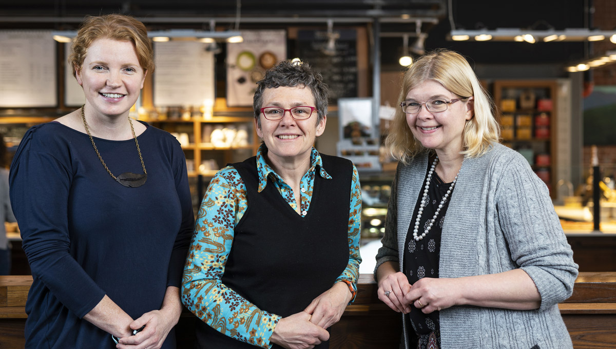 Kate Burnett, Tracey Clark and Dana Brown pose together at a Bridgehead.