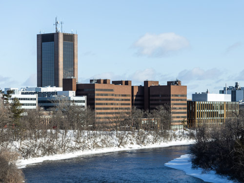 The south-facing side of Carleton's campus next to the RIdeau River on a sunny winter day.