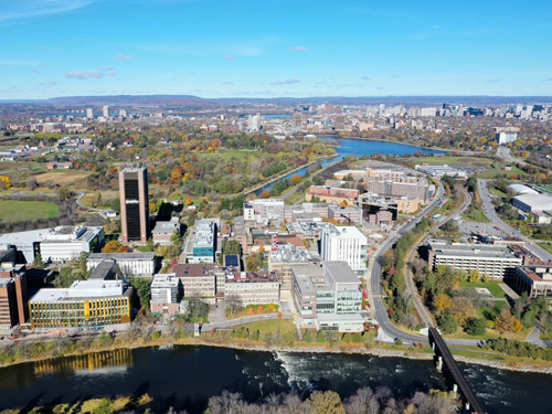 Aerial view of Carleton University's campus and the Rideau River