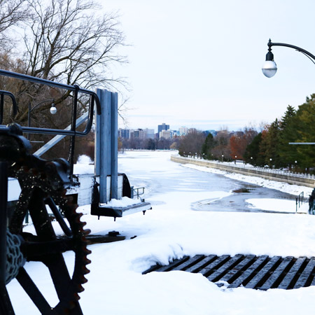 A shot of the Rideau Canal with downtown Ottawa in the distance.