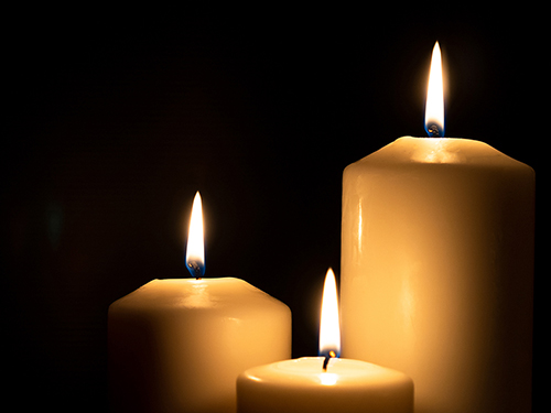 Candles burning on a black background