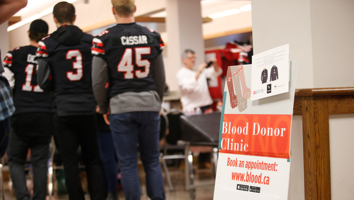 A sign advertises the blood drive. The Ravens men's football team helped collect an impressive 78 pints of blood on Nov. 30, 2018 at their Give Life blood donation clinic on Carleton University's campus.