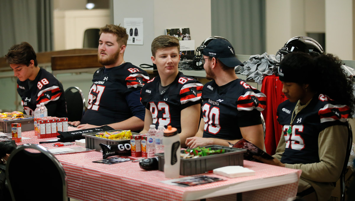 The Ravens men's football team eats cookies after donating blood during a blood drive in which they helped collect an impressive 78 pints of blood on Nov. 30, 2018.