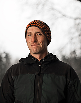 A photo of Carleton University researcher Stephan Gruber. Gruber is wearing a black jacket and a toque with an orange pattern.