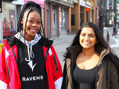 Taijah Cox-Armstrong, left, and her Carleton University roommate Rhea D'Souza, right, have so far distributed 11 'COVID-19 care packages' to people in Ottawa's ByWard Market. (Stu Mills/CBC)