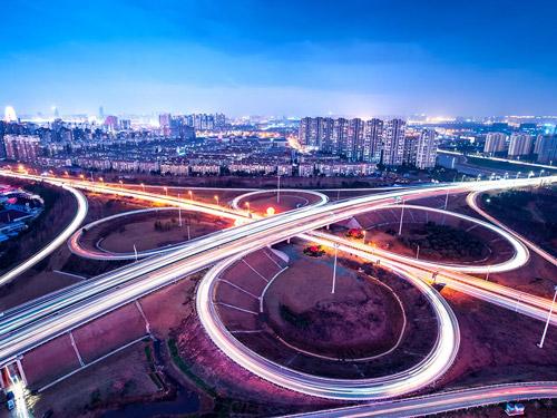 A busy freeway interchange at dusk.