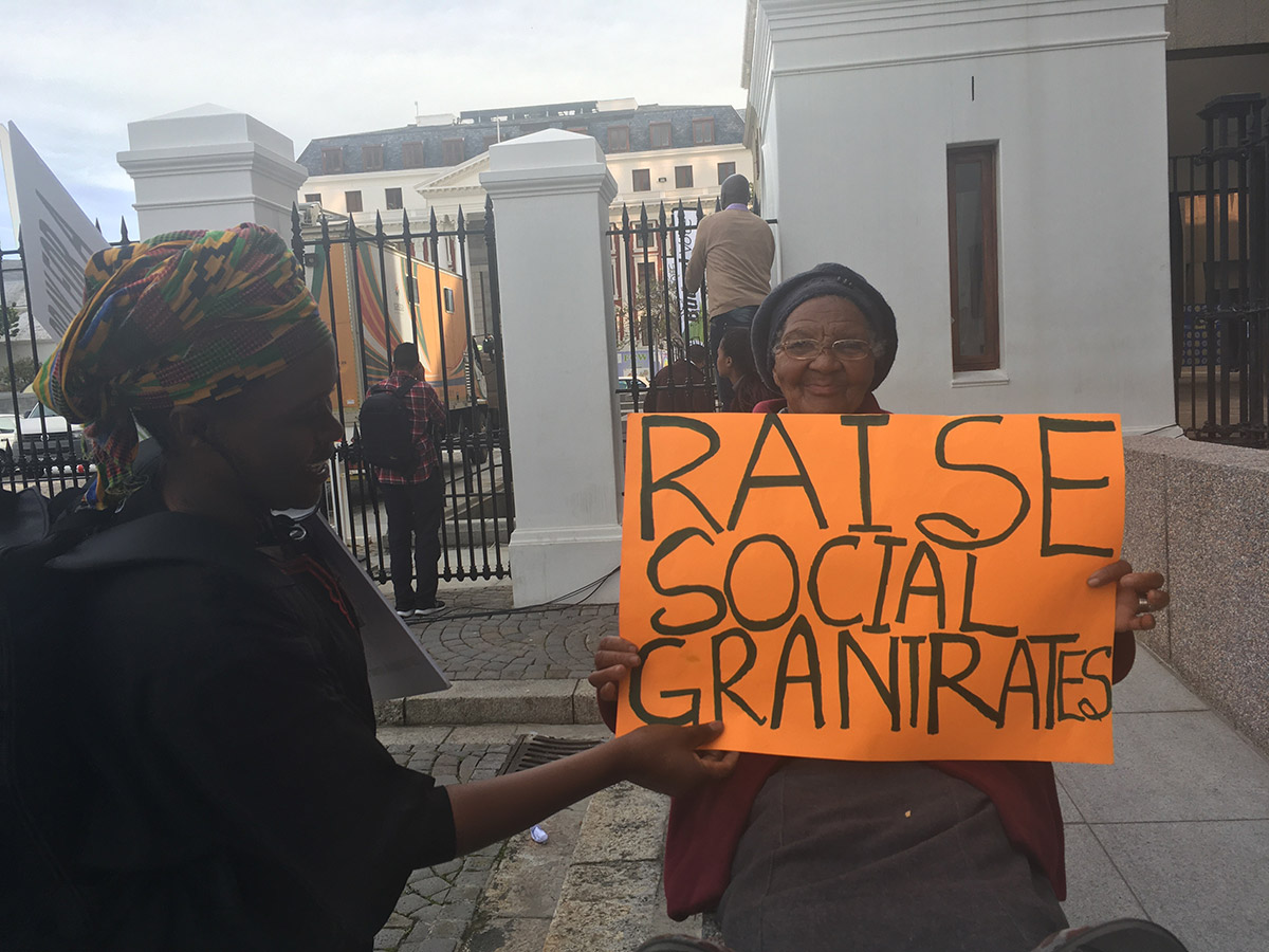 Social grant recipients rally outside parliament in Cape Town, South Africa calling for increases to grant rates in 2017. (Christopher Webb)