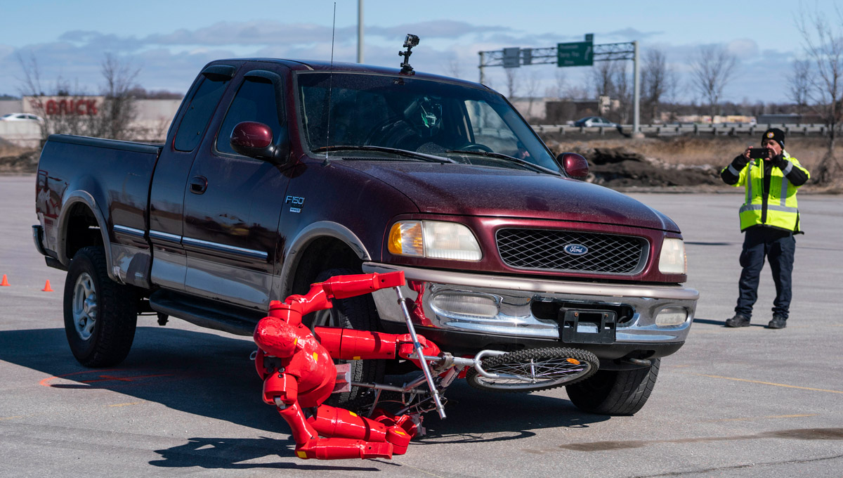 A truck collides with the crash test dummy.