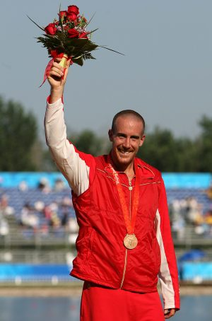 Canada's Thomas Hall shows off his bronze medal after competing in the C1 1000M final at the at the Shunyi Olympic Rowing-Canoeing Park during the 2008 Beijing Olympic Games