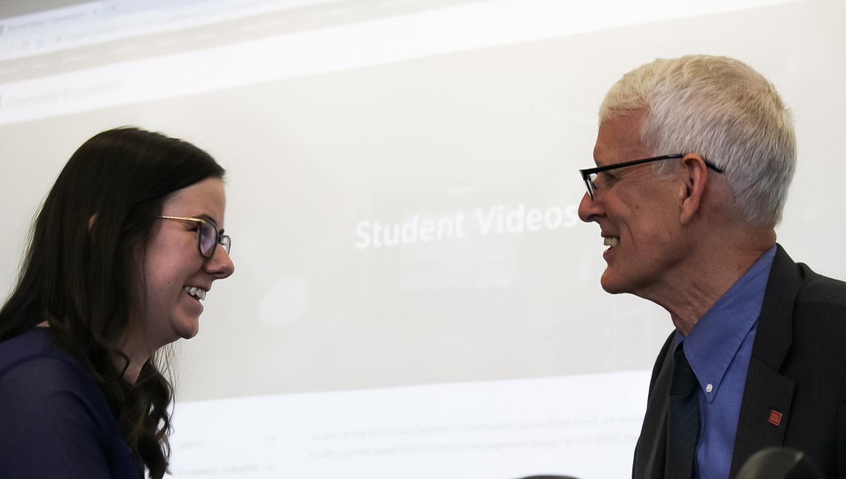 Jerry Tomberlin awards a prize to student Victoria Bond