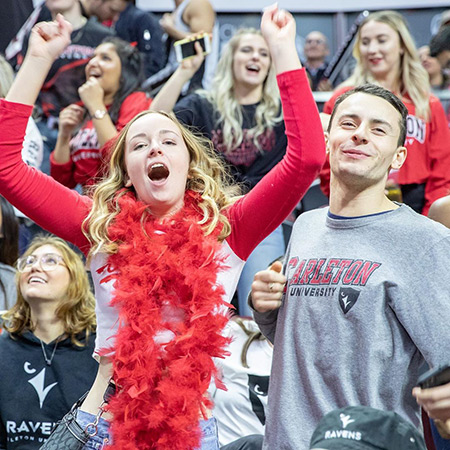 Carleton University students cheer their team at the Capital Hoops Classic in 2019.