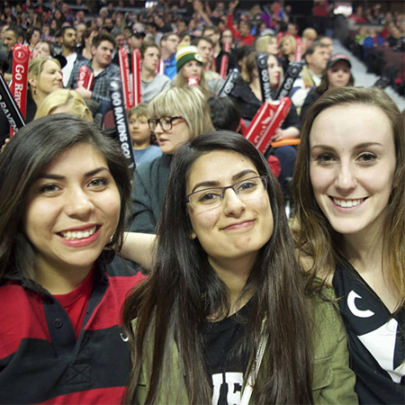 Carleton University students at a Carleton Ravens basketball game.
