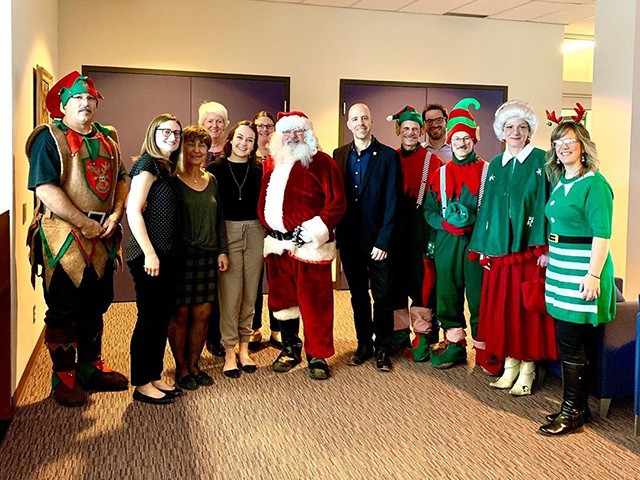 A photo of various Carleton University staff members, including the President Benoit-Antoine Bacon, wearing festive clothes to celebrate the holiday.