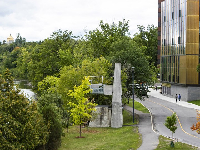 A photo of the Carleton University campus with the ARISE building visible in the background.