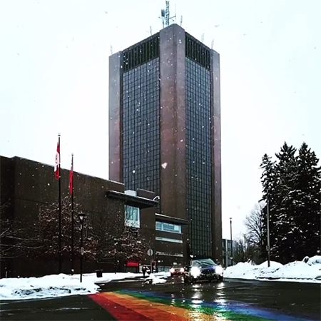 A snowy scene with Carleton's rainbow road and Dunton Tower visible