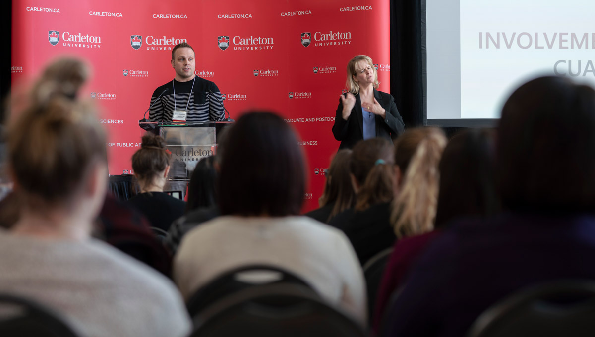 Jeremy Brzozowski speaks during the Carleton University Accessible Experiential Learning Showcase.