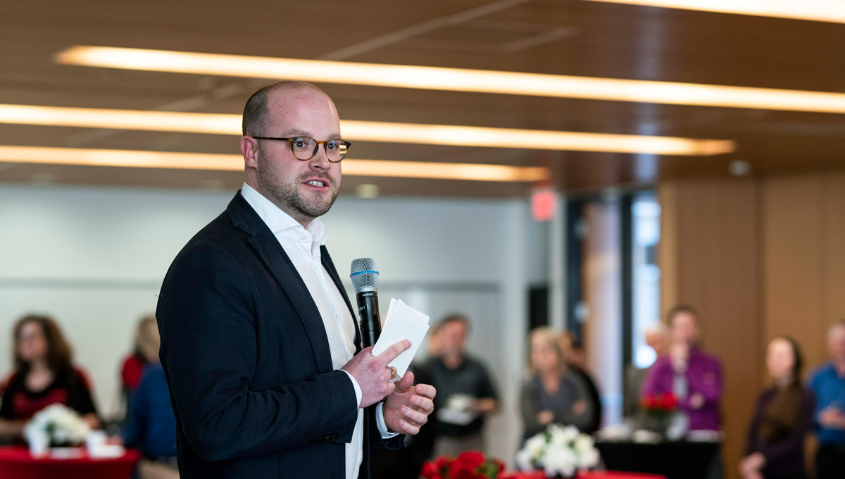 David Hornsby speaks at an event launching Teaching and Learning Services' collection of 67 short stories from Carleton's faculty members and staff in February 2019.