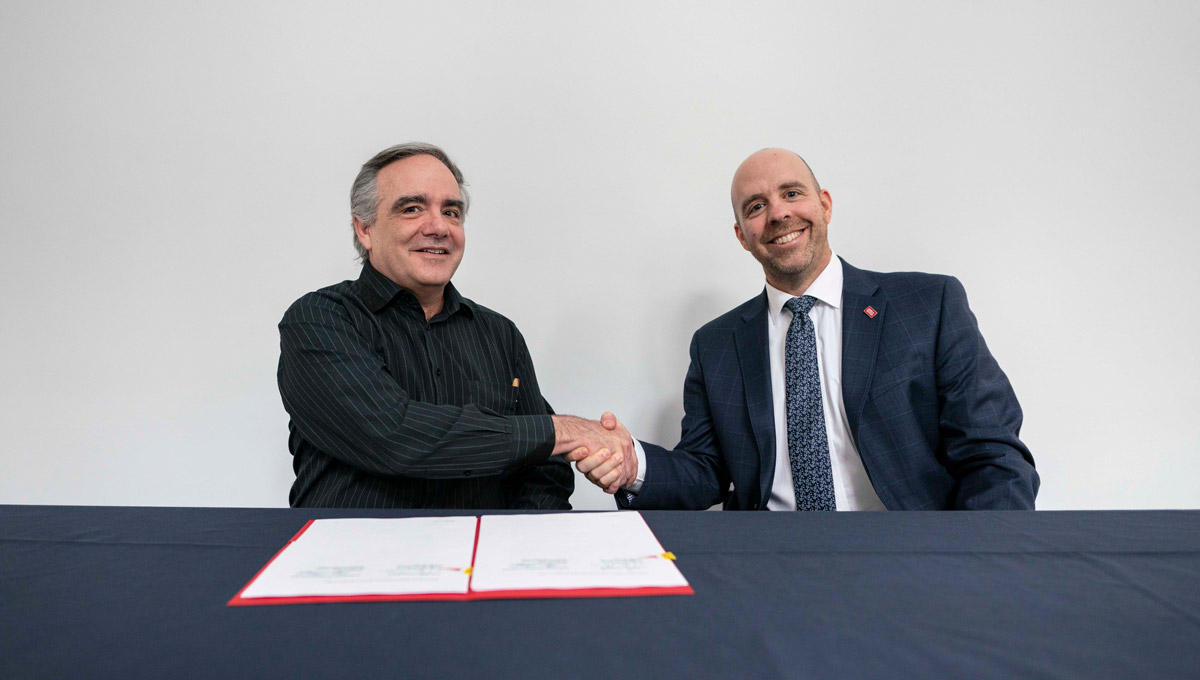 Carleton President Benoit-Antoine Bacon and Dominican University College President Maxime Allard sign a document renewing their Affiliation Agreement.