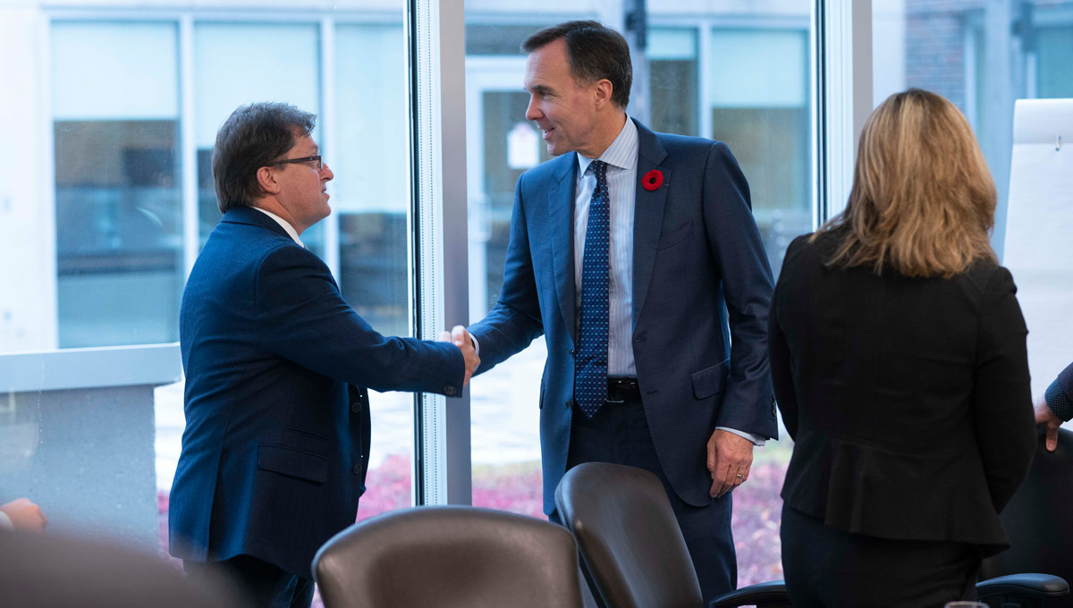 Bill Morneau shakes hands with an event attendee. The Honourable Bill Morneau, Minister of Finance, on behalf of the Honourable Amarjeet Sohi, Canada's Minister of Natural Resources, announced changes to Canada's Energy Efficiency Regulations to help Canadian homes and businesses save money by using more energy-efficient products. The announcement took place at Carleton in October 2018.