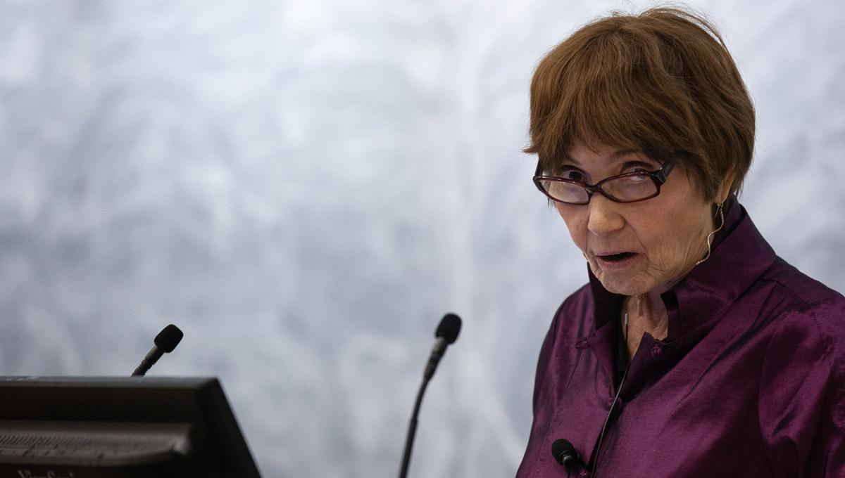 Elizabeth Abbott speaks at a podium