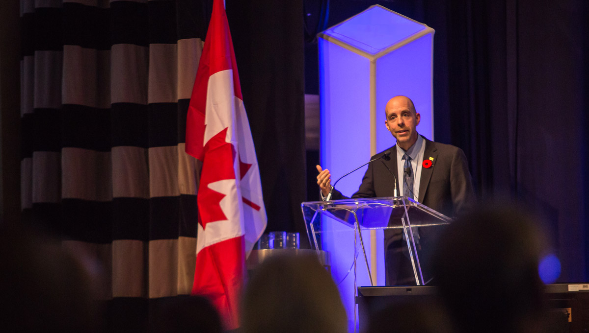 President Benoit-Antoine Bacon speaks at a podium during the Excellence Canada awards ceremony.