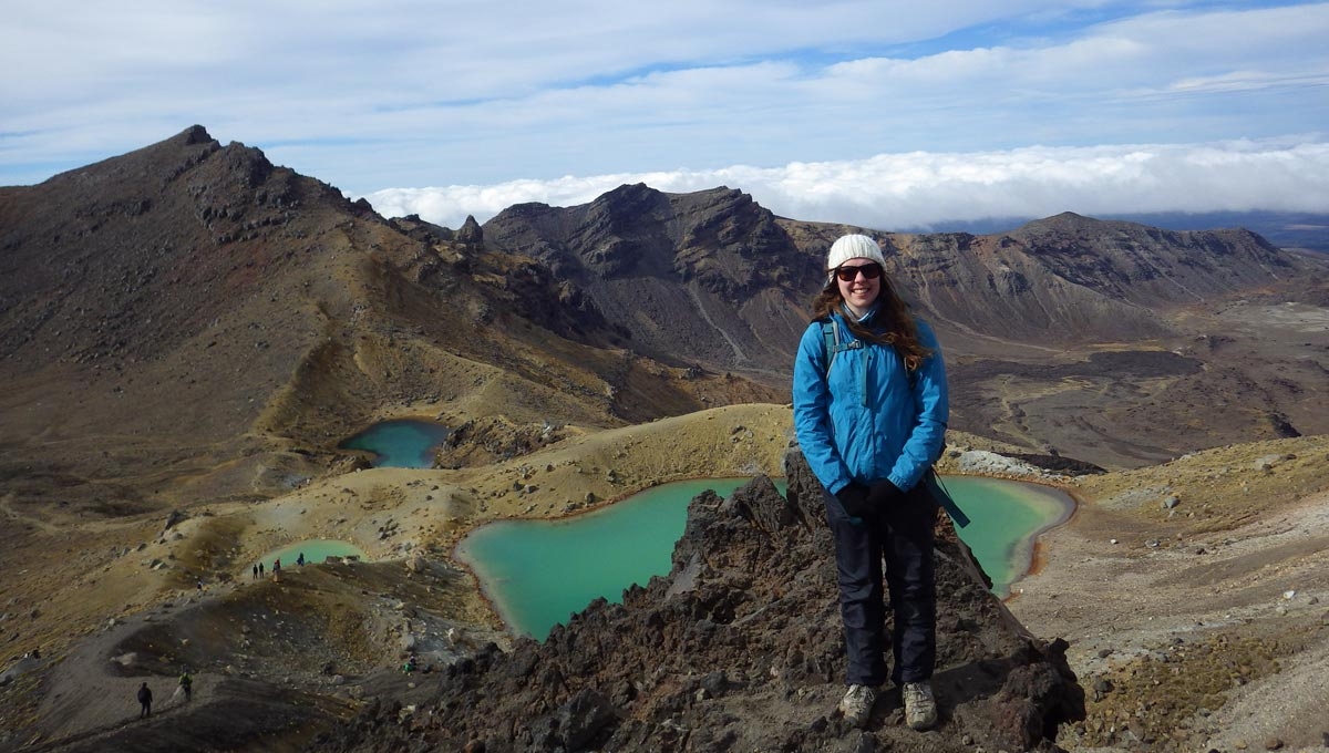 Marissa Davies in front of the Emerald Lakes on the Tongariro Alpine Crossing