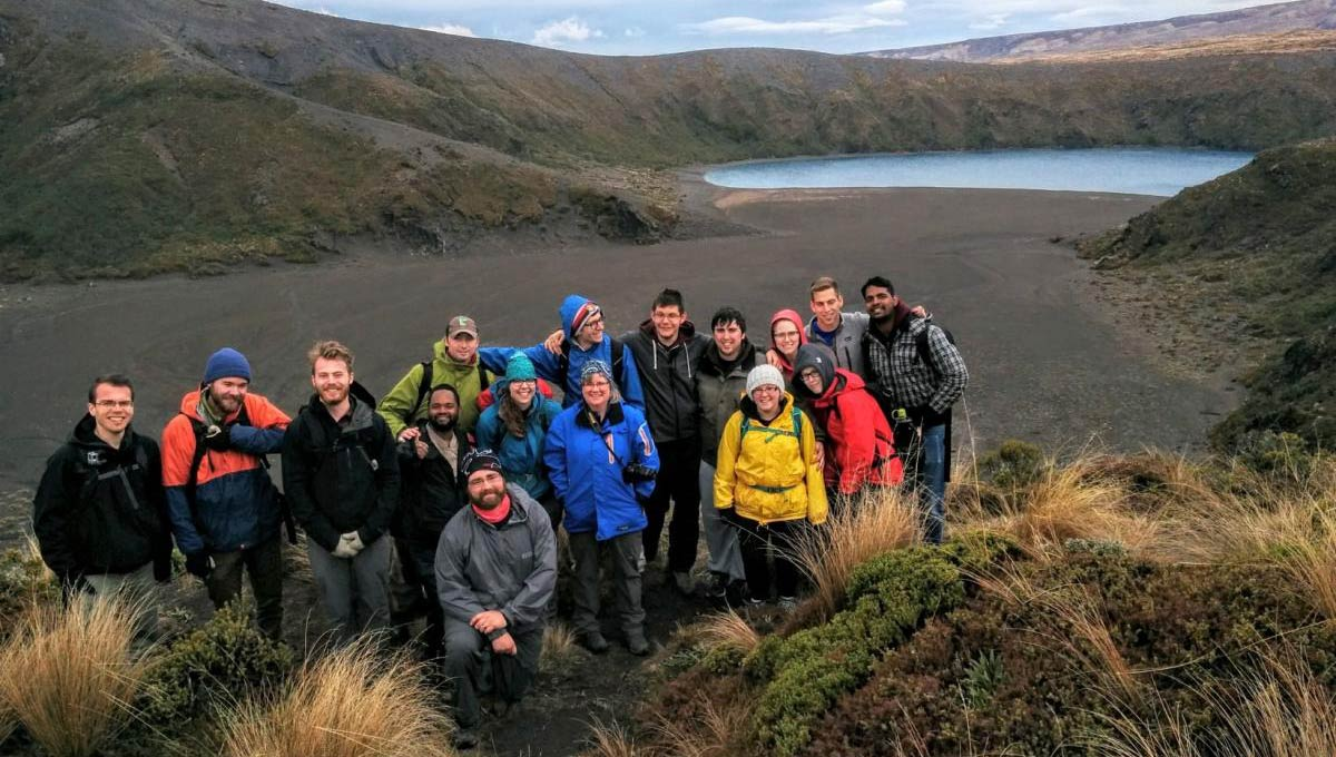 The group hiked to the Tama Lakes at the foot of Mount Ruapehu. The lake in the background is an ancient crater.