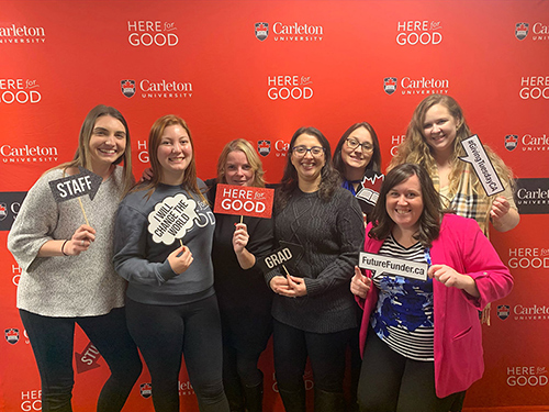 A group of Carleton University staff members celebrate at a Giving Tuesday event.