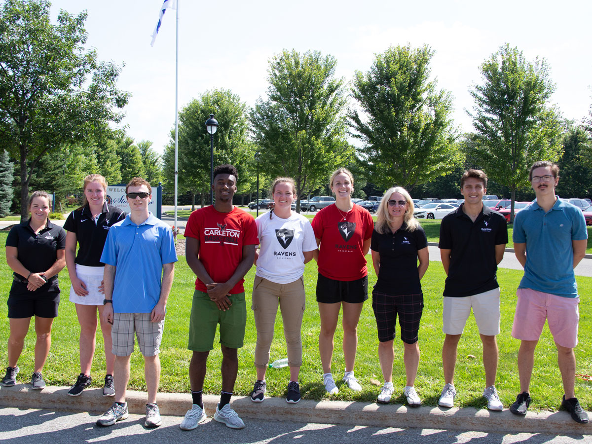 Volunteers line up as participants in Carleton's 13th annual President's Golf Tournament teed off Aug. 20 at Stonebridge Golf Club, raising $140,000 for student athletes.