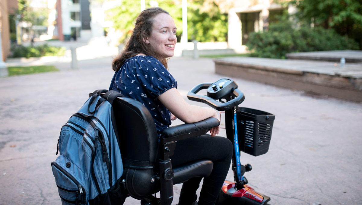 Hannah MacLellan commutes around Carleton's campus. Hannah has accomplished a lot at the age of 19 and she's just getting started in her life-long quest for disability rights.