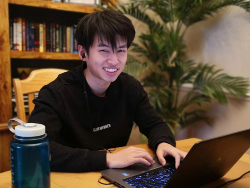 iContribute co-founder HaoHapo Du at a laptop