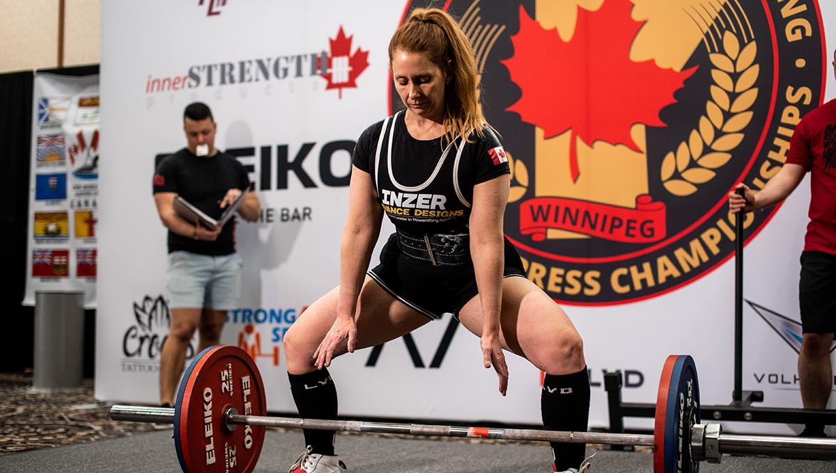 Prof. Jennifer Evans prepares to lift