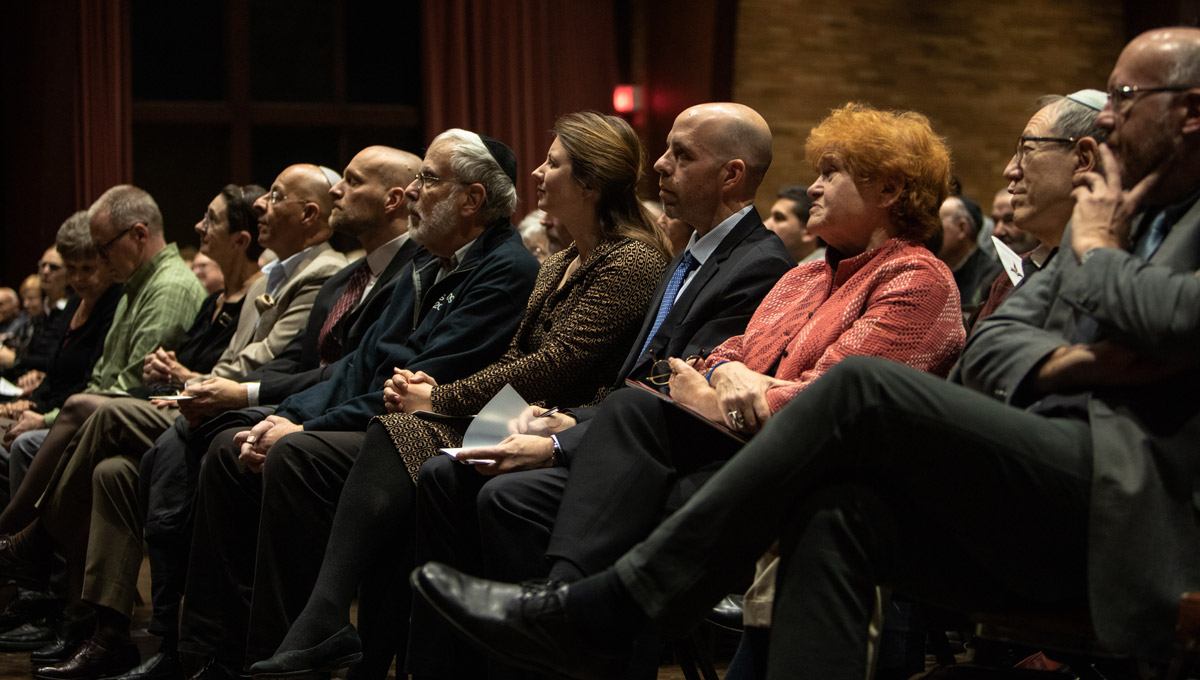 Historian Deborah Lipstadt sits next to Carleton President Benoit-Antoine Bacon and other members of the audience.