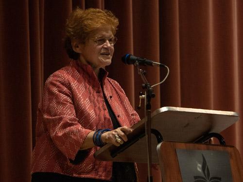Historian Deborah Lipstadt speaks at a podium.