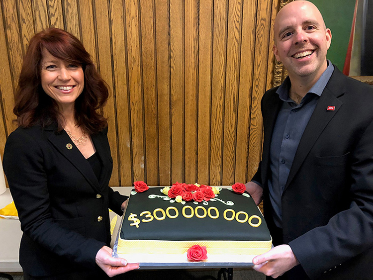 Chief Advancement Officer Jennifer Conley and President Benoit-Antoine Bacon celebrate reaching and surpassing the Collaborate Campaign's $300 million goal in April 2019.