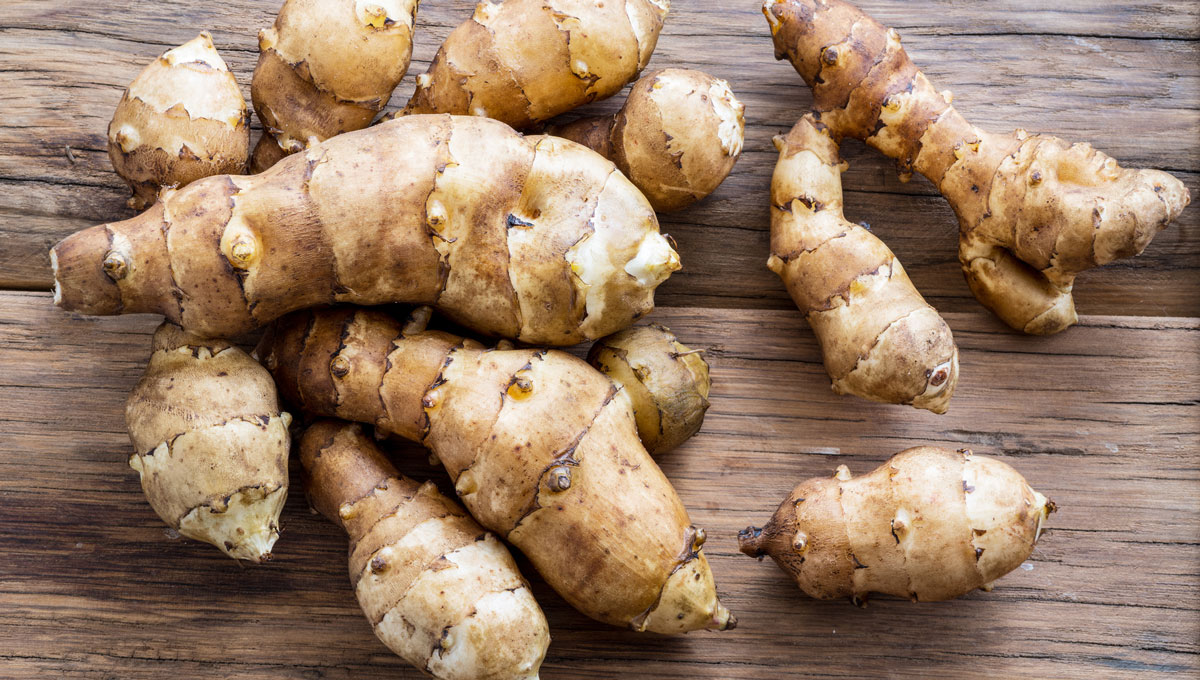Jerusalem artichokes on a wooden table. Postdoctoral fellow Aynur Gunenc is exploring how to make processed meat products healthier using the nutritional properties of the Jerusalem artichoke.
