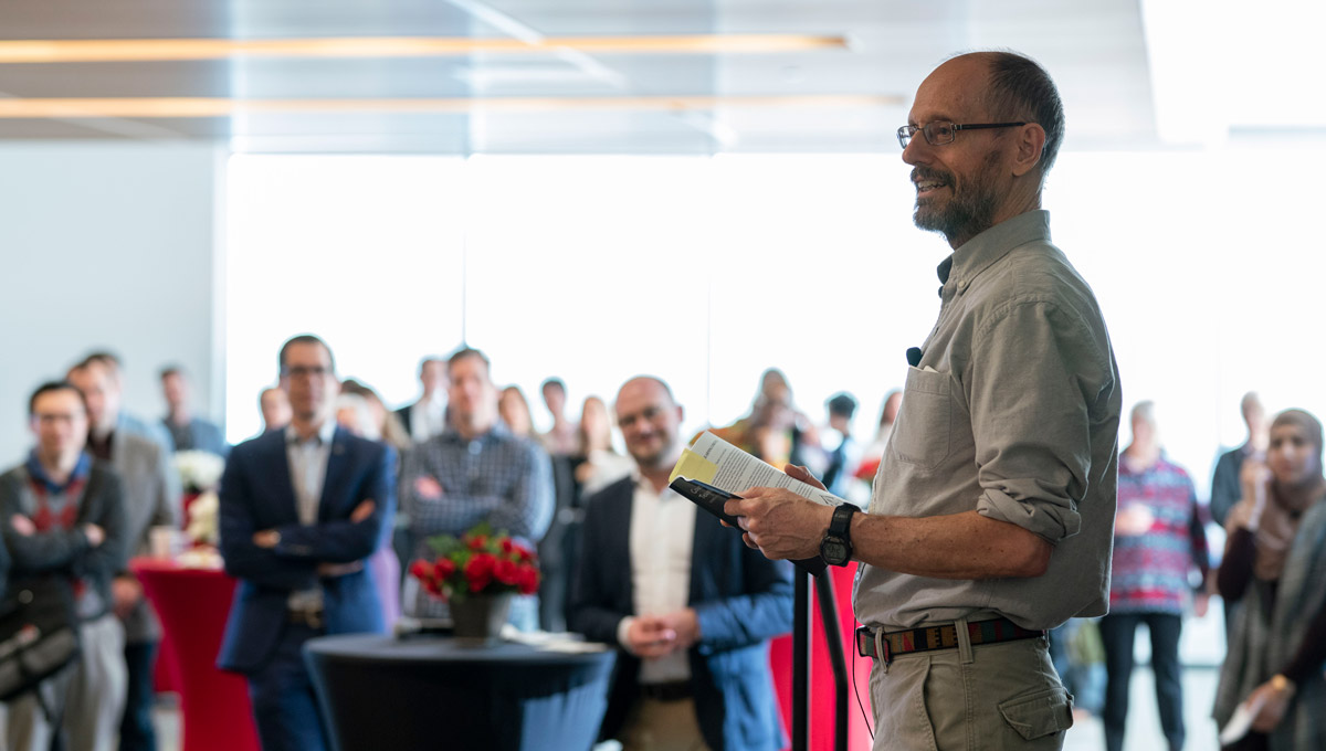 Carleton's John Chinneck speaks at an event launching Teaching and Learning Services' collection of 67 short stories from Carleton's faculty members and staff in February 2019.