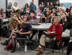 """The audience listens during an event examining the term """"genocide"""" in Canada's recent Indigenous Report"""