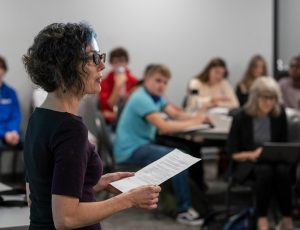 """Prof. Jennifer Henderson speaks during an event examining the term """"genocide"""" in Canada's recent Indigenous Report"""
