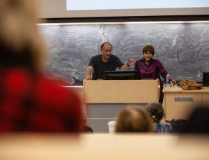 Angelo Mingarelli, chair of Cinquecento and author Elizabeth Abbott speak at a podium together.