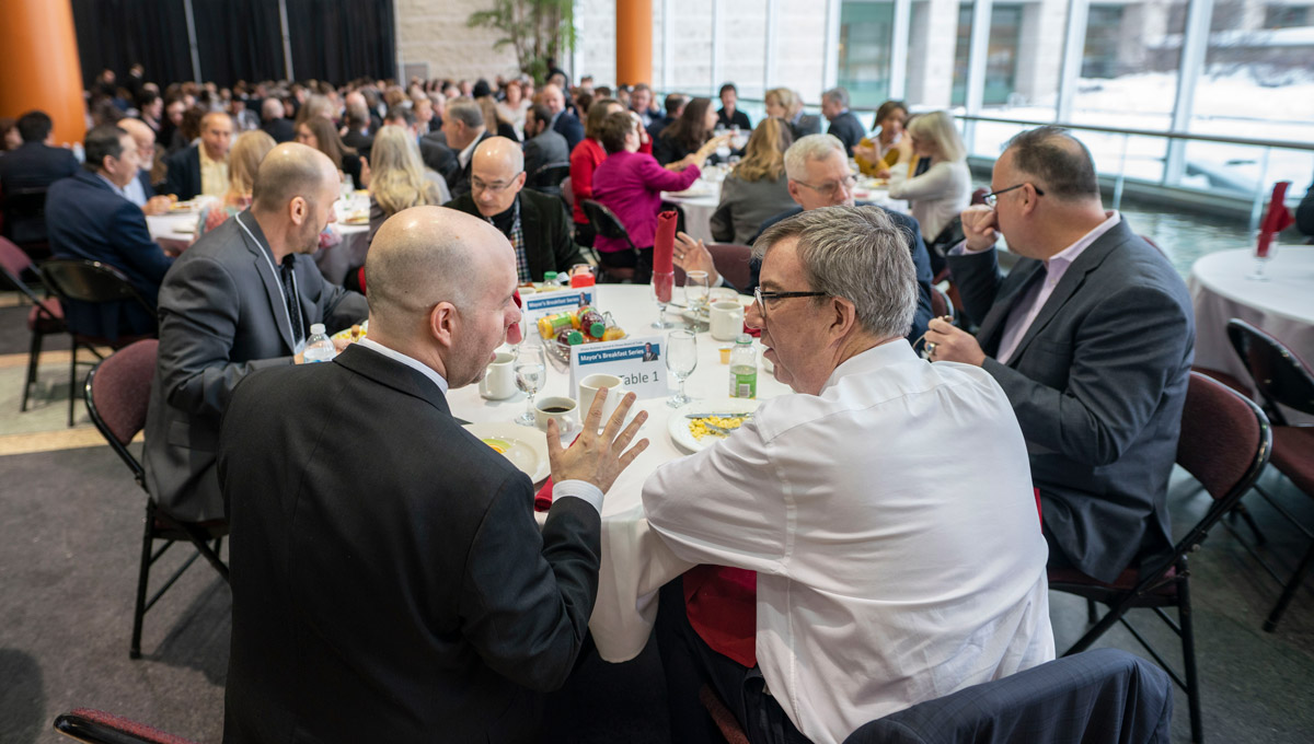 President Benoit-Antoine Bacon has breakfast with Jim Watson before his speech at the Mayor's Breakfast Series at Ottawa City Hall on Feb. 12, 2019.