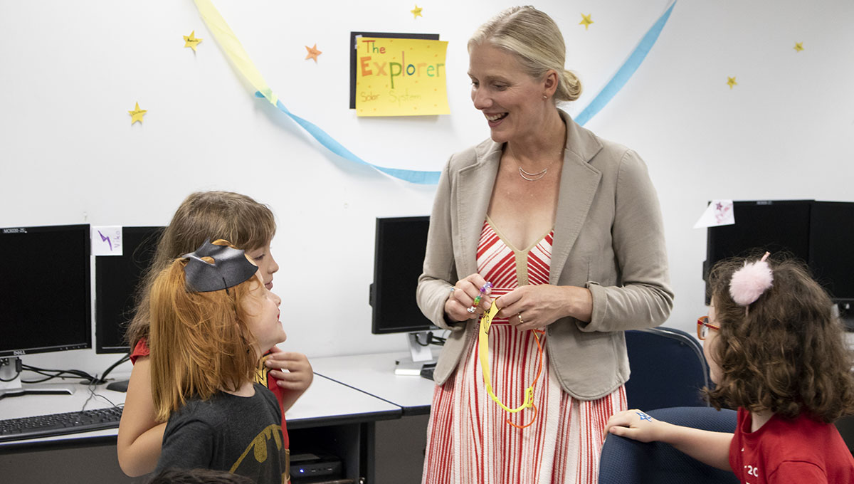 Costumed campers in Carleton's Virtual Ventures program interact with Catherine McKenna, minister of Environment and Climate Change.