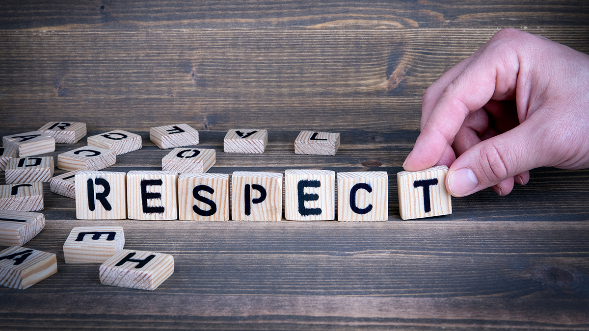 Scrabble pieces that spell out the word respect