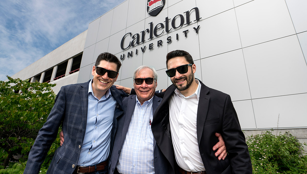 Photo of Prof. Tony Bailetti (middle) with his sons Eduardo and Marco, all wearing sunglasses