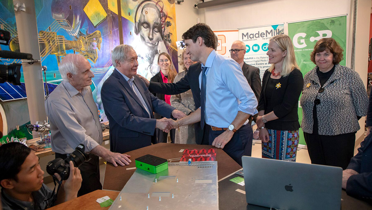 Photo of Prof. Tony Bailetti shaking hands with Prime Minister Justin Trudeau