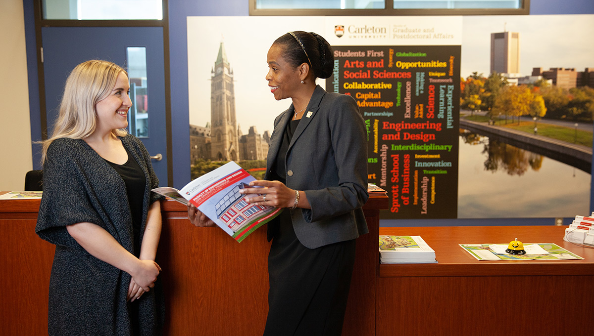 Patrice Smith, Dean of the Faculty of Graduate and Postdoctoral Affairs, speaks with a colleague.