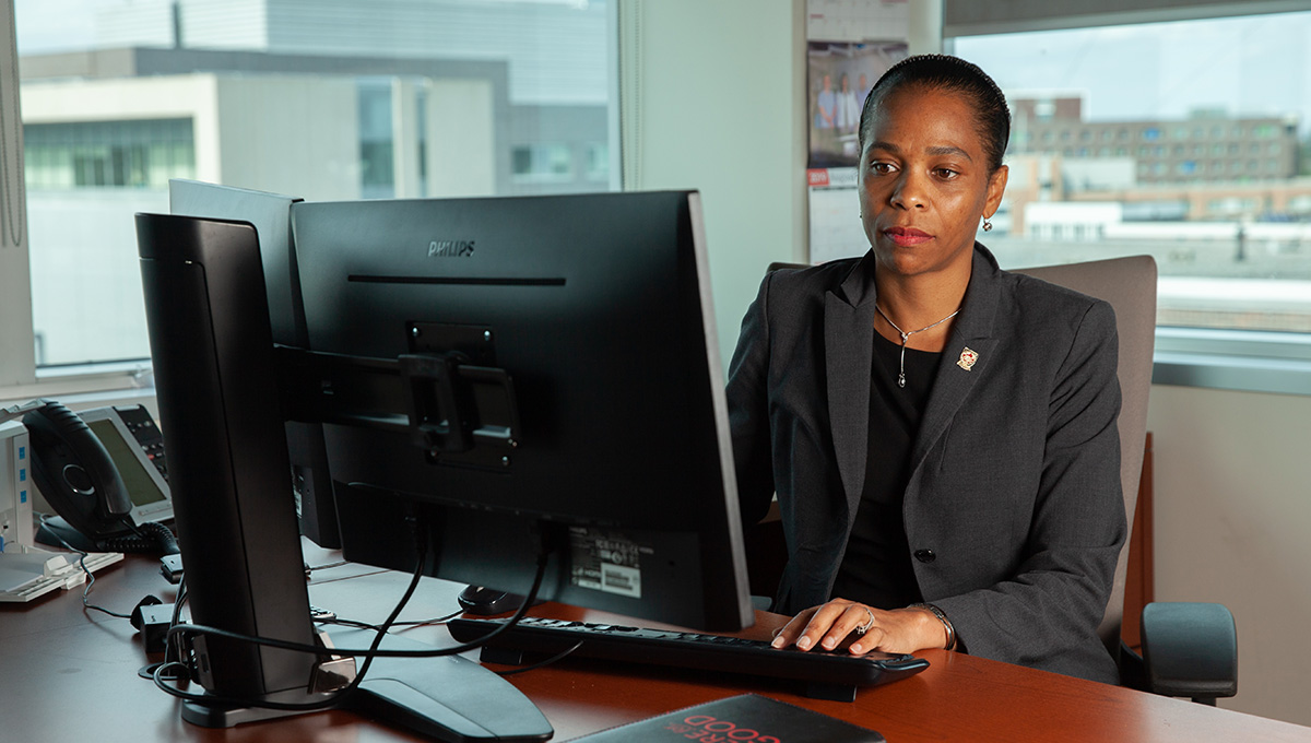 Patrice Smith, Dean of the Faculty of Graduate and Postdoctoral Affairs, working at her desk.
