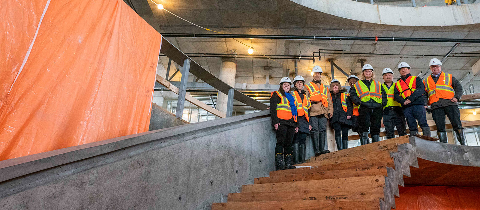 Members of the Carleton community examine the new Sprott building