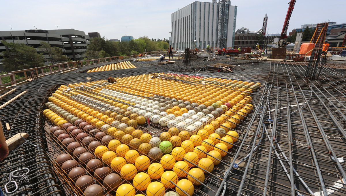 The new Sprott building will feature a void concrete slab system, manufactured by BubbleDeck North America LLC. This innovative approach significantly reduces the weight of the building and promotes sustainability by replacing typical cast-in place concrete slabs with frames of recycled plastic bubbles over which concrete is poured.