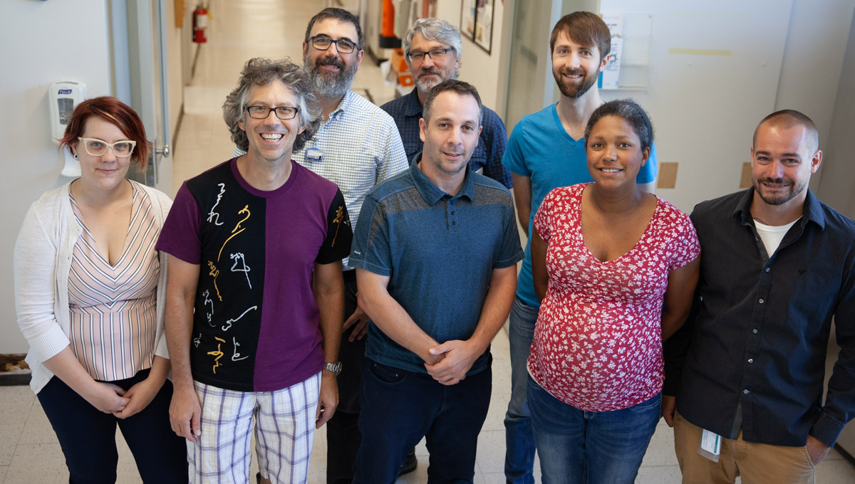 Members of the Ottawa Medical Physics Institute pose in a lab setting.